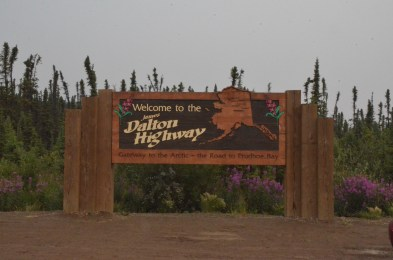 "The start of the Dalton Highway is marked by this sign, this is where the road turns from a paved country road into the gravel ""haul road"" headed over 400 miles north to Prudhoe Bay."