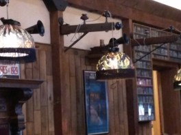 Lamps hanging from telegraph wire posts and glass insulators