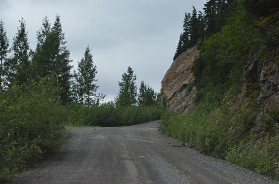 The road to Salmon glacier cut into the hillside.