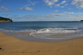 Water swirls on the sand