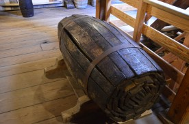 A pair of broken down barrels. On a whaling ship the barrels need to be out of the way until filled with oil.