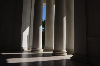 Marble floor and columns, dramatic lighting.