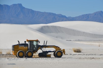 """The """"roads"""" here on the edge of the dunes are graded smooth and sand piled along the sides."""