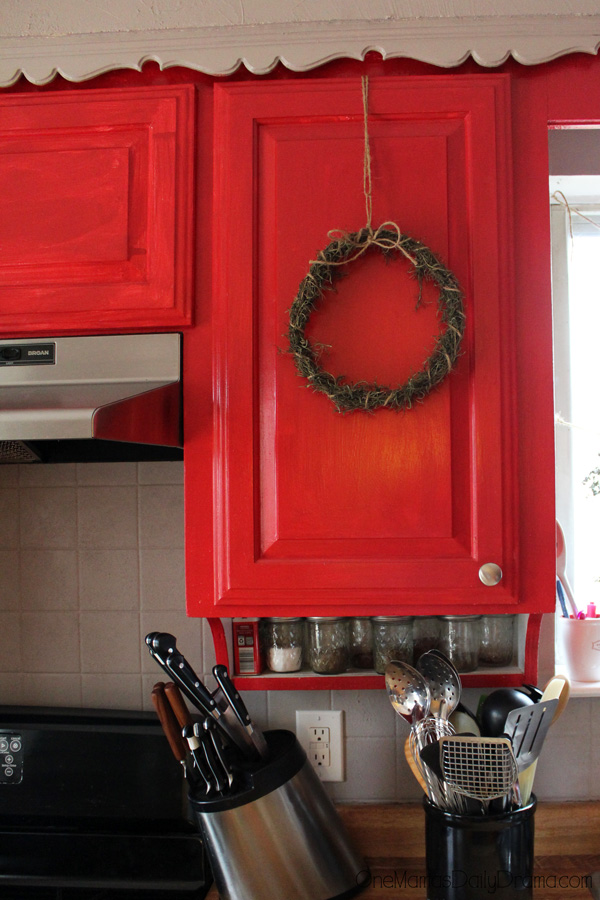 Holiday home decor: rosemary wreaths on the kitchen cabinets