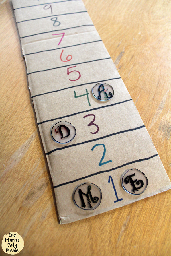 This DiY game level tracker is easy to make with Shrinky Dink plastic.