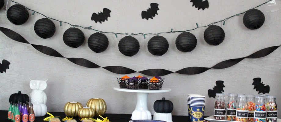 Magical Halloween party theme | Classy black and white pumpkins mixed with wizard potions and tableware make for a fun evening for kids and adults.