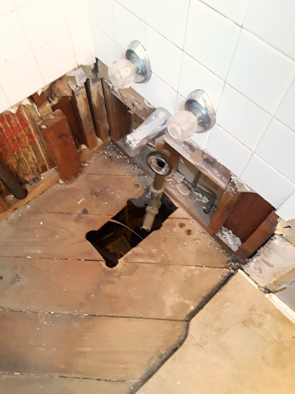 bathroom remodel: plumbing below the tub
