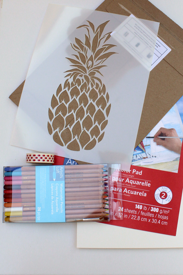 craft supplies: pineapple stencil, watercolor paper, watercolor pencils
