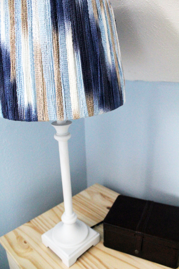 Take any lamp from basic to wow with a little paint and yarn. This thrift store lamp makeover is amazing, yet simple to do with everyday craft supplies.