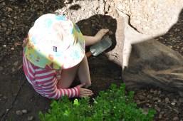 Burying her feet