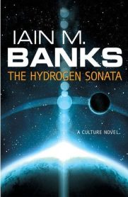 Book cover: The Hydrogen Sonata - Iain M Banks (a sun appearing around the edge of a planet causing lens flare, all blues)