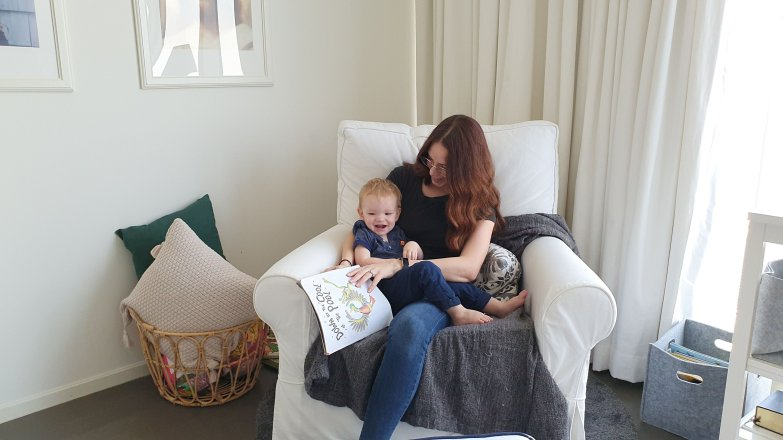 Mom reading to son