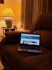 Christine from Wood-Ridge, New Jersey. Just want to show you my favorite place when I want to put my feet up and surf the Interwebz (the living room reclining loveseat).