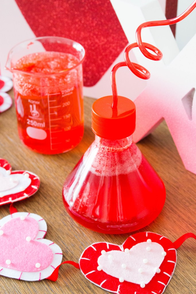 This no mess, four ingredient Poppin' Love Potion drink recipe is one of the best Valentine's Day activities for kids! Watch this magic potion drink fizz and bubble when you add the secret ingredients! Includes a step-by-step video tutorial!