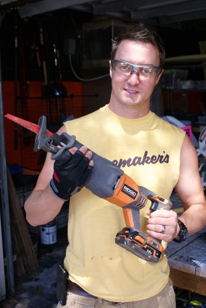 A happy camper with his RIGID reciprocating saw.