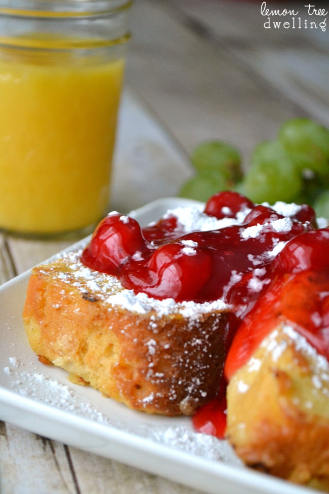 Pound Cake French Toast topped with cherry pie filling and powdered sugar. The BEST Christmas breakfast!