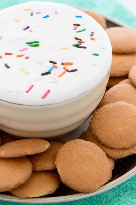 Funfetti Cheesecake Dip - Sweet cheesecake dip with funfetti sprinkles. So easy and perfect with graham crackers, vanilla cookies, or your favorite fruit.