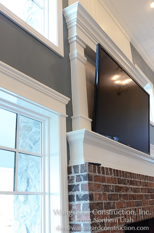 Love the mantle and tv frame. Lots and lots of finish work ideas!!