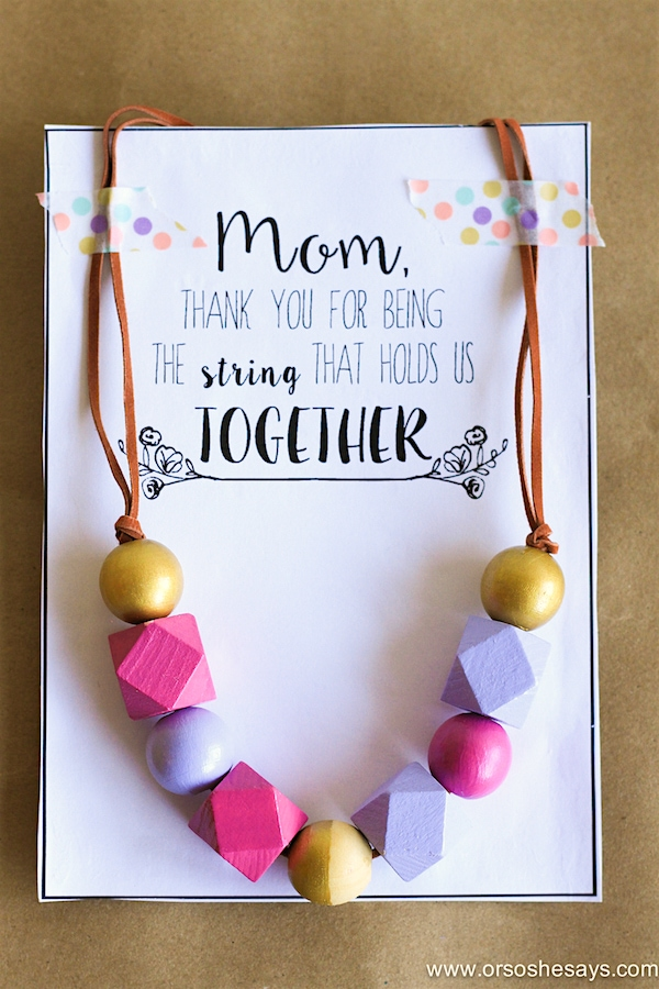 Or So She Says- This Mother's Day Necklace idea is the perfect gift for any woman in your life! Make one with the kids today! Plus it comes with a free printable card to finish it off.
