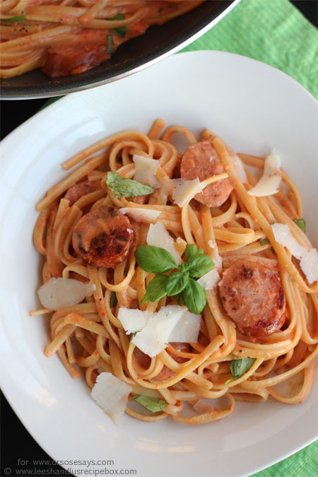 Roasted red pepper and sausage alfredo is a crowd-pleaser! Check out the recipe today on www.orsoshesays.com.