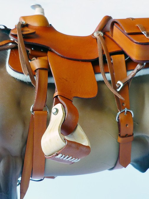 Commission 008 - detail of tan western saddle using resin saddle tree and stirrups