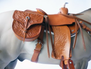 Tan saddle with embossed flame detail