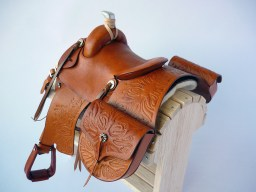 Tan saddle and saddlebags with embossed flame detail