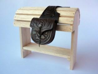 Dark brown saddlebags with embossed rose detail