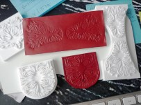 3D stamps second tests, too detailed for the process, shown with leather tests