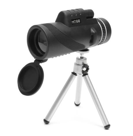 Left side view of camera lens on tripod