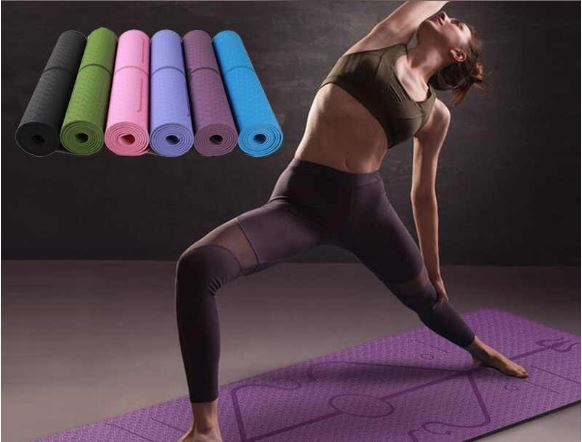 Women working out on purple Yoga Mat