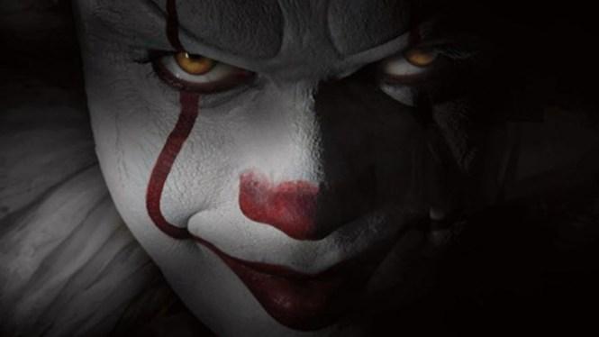 IT's coming...Bill Skarsgård as Pennywise in IT. Image via Screen Junkies News | IT Movie | onetakekate.com