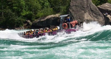 Whirlpool Jetboat smashing through rapids at Devil's Hole, Niagara River