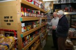Owner Jerry McKenna shows Ted Driscol of Amherst some of his hot sauce display