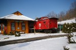 The old Railroad Station and caboose that made up the original building at Unusual Junction