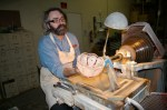 Master glass carver Aiden Scully at work at Crystal Traditions in Tiffin