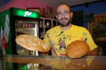 Jason Cannon holding loaves of Hippie Bread and Far Out Faranucci