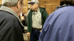 Auctioneer Chuck Smith, one of two auctioneers selling merchandise in the auction barn