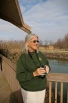 Mary Warren, Magee Marsh Naturalist, scans horizon for arrival of new birds