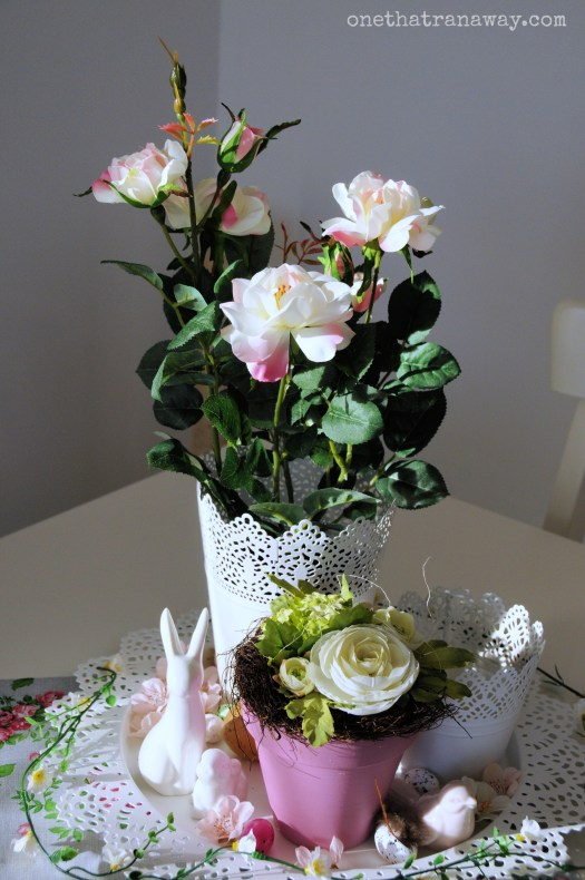 easter center piece with rabbit figurines and flowers