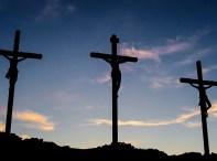 Jesus hanging on a cross between two criminals