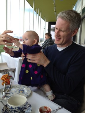 Celebrating daddy's birthday....hmmm, she might be getting ready for solids!