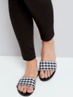 http://www.newlook.com/shop/shoe-gallery/view-all-shoes/black-gingham-mules_526529009