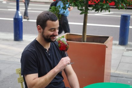 person drinking cocktail