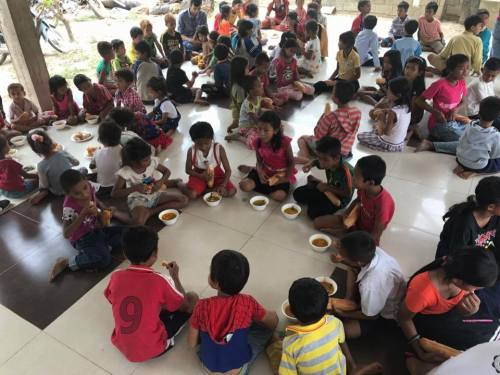 Children during a feeding program activity
