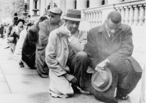 "CREDIT: ""[African-Americans kneel on sidewalk outside City Hall in Birmingham, Alabama protesting racial segregation]."" United Press International telephoto, 1963. Prints and Photographs Division of the Library of Congress. CREDIT: Lyon, Danny, photographer. ""[Civil rights activists occupying a lunchroom counter during a sit-in]."" [between 1962 and 1964]. Prints and Photographs Division of the Library of Congress."