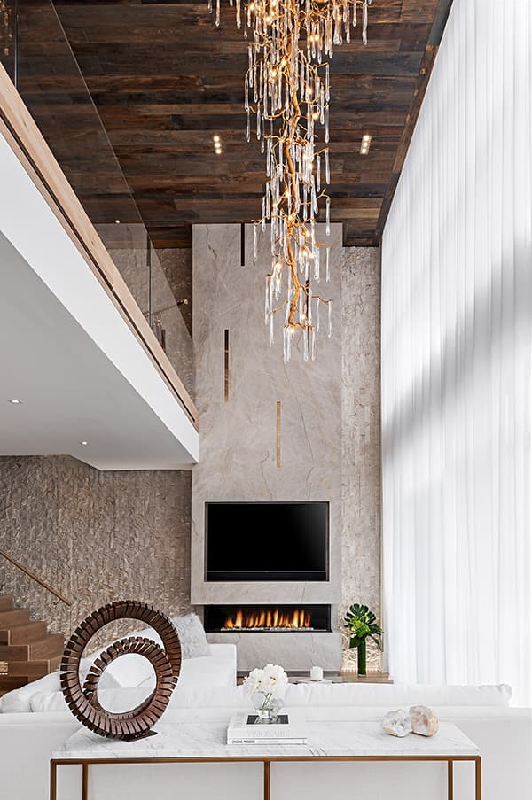 Fireplace and chandelier in luxury home
