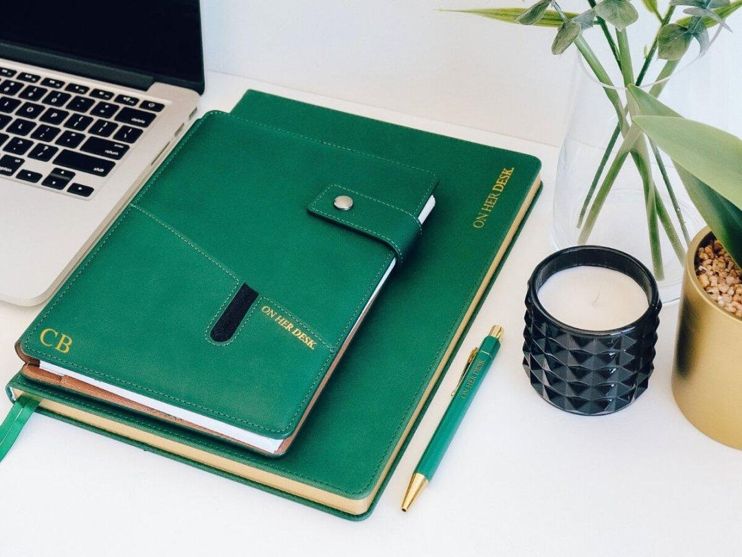 on her desk notebooks monogrammed