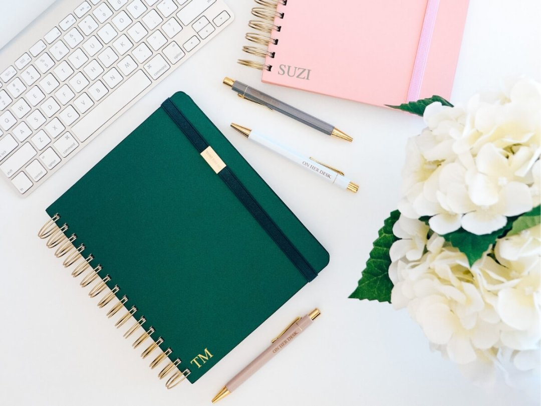 personalised notebooks from on her desk