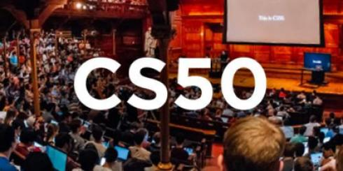 "The text ""CS50"" over an image of students in a large lecture hall."